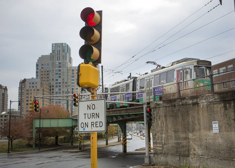 An MBTA Green Line trolley on the overpass of Route 28 pulls into Lechmere Station in Cambridge. (Jesse Costa/WBUR)