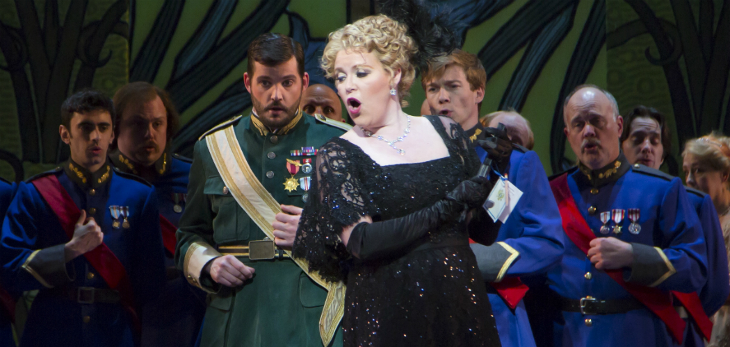 """Erin Wall, as Hanna Glawari, surrounded by the ensemble of Boston Lyric Opera's production of """"The Merry Widow."""" (Courtesy of T Charles Erickson/BLO)"""