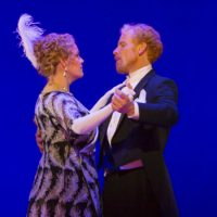 """Erin Wall, as Hanna Glawari, dances with Roger Honeywell, Count Danilo, in Boston Lyric Opera's production of """"The Merry Widow."""" (Courtesy of T Charles Erickson/BLO)"""