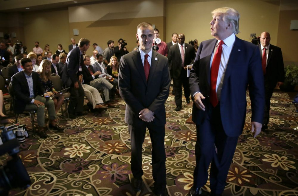 In this file photo, Republican presidential candidate Donald Trump walks with his campaign manager Corey Lewandowski after a press conference in Iowa. (Charlie Neibergall/AP)