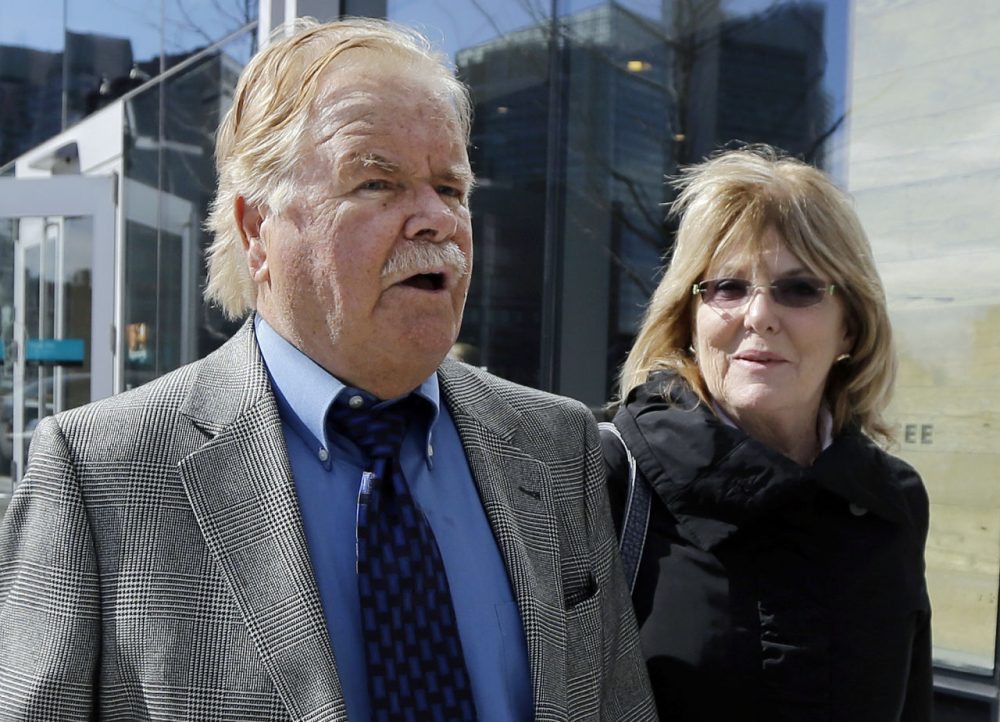 Robert Fitzpatrick walks from federal court in Boston in April 2015, accompanied by his wife, Jane. (Elise Amendola/AP)