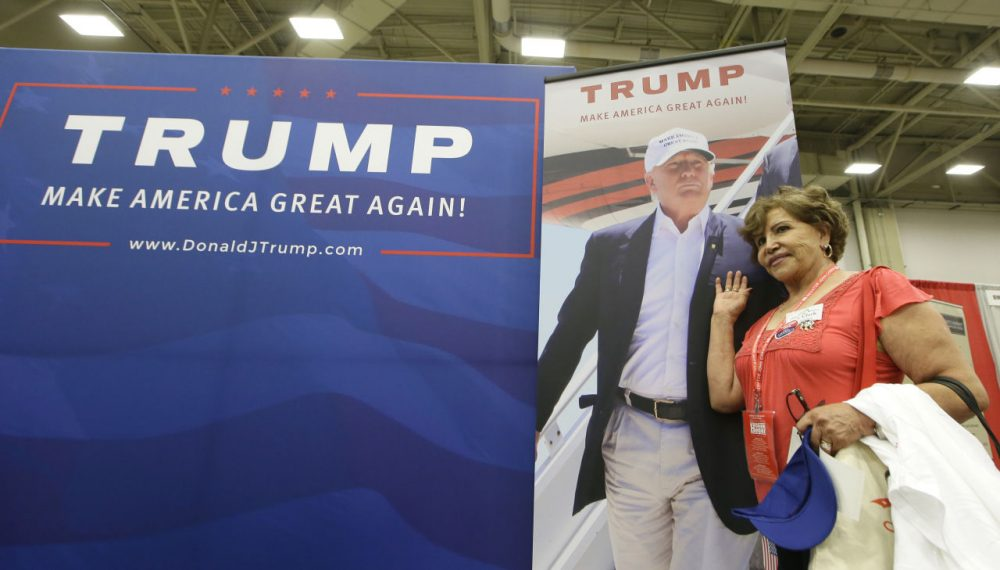 El Paso delegate Regina Jarvis poses for a photo with a photo of Donald Trump during the Texas Republican Convention on May 12 in Dallas. (LM Otero/AP)