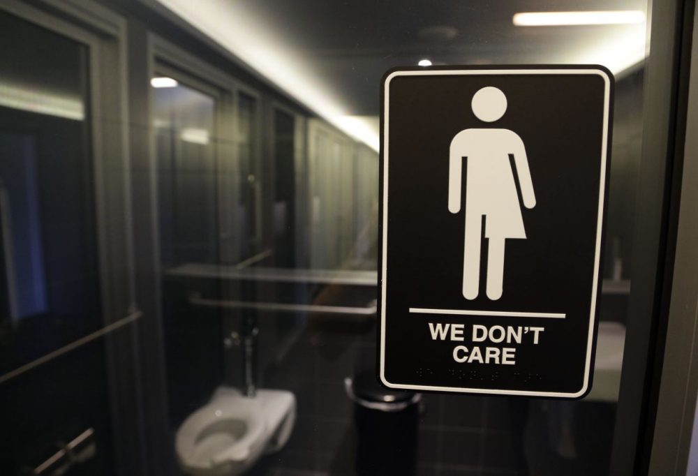 Signage outside a restroom at 21c Museum Hotel in Durham, N.C. The Mass. Senate passed the Transgender Accommodations bill on Thursday . (Gerry Broome/AP)