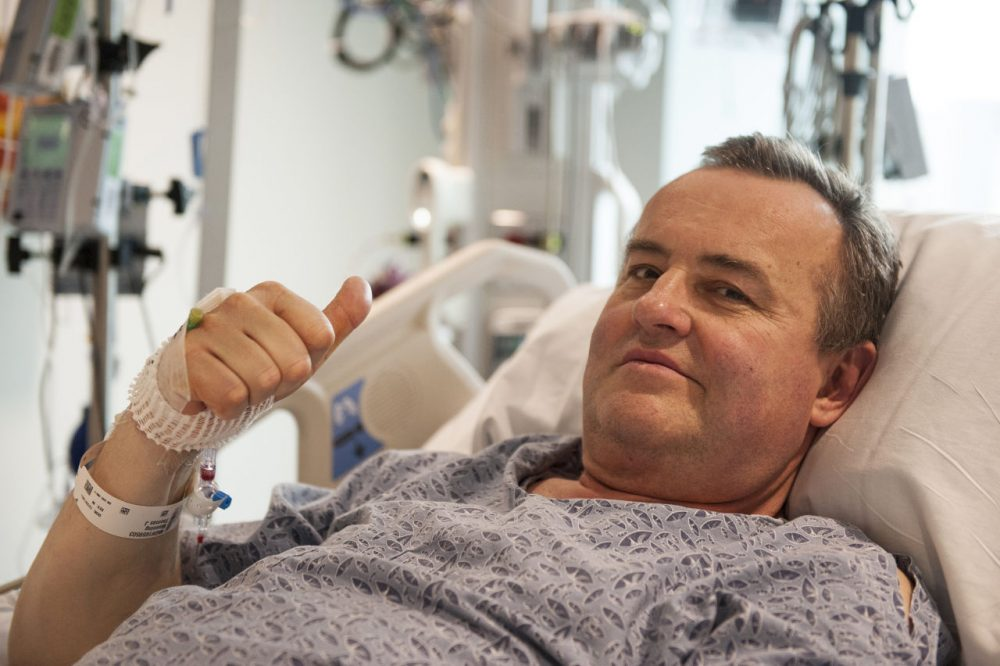 In this photo provided by Massachusetts General Hospital, Thomas Manning gives a thumbs up after being asked how he was feeling following the first penis transplant in the United States. (Sam Riley/Mass General Hospital via AP)