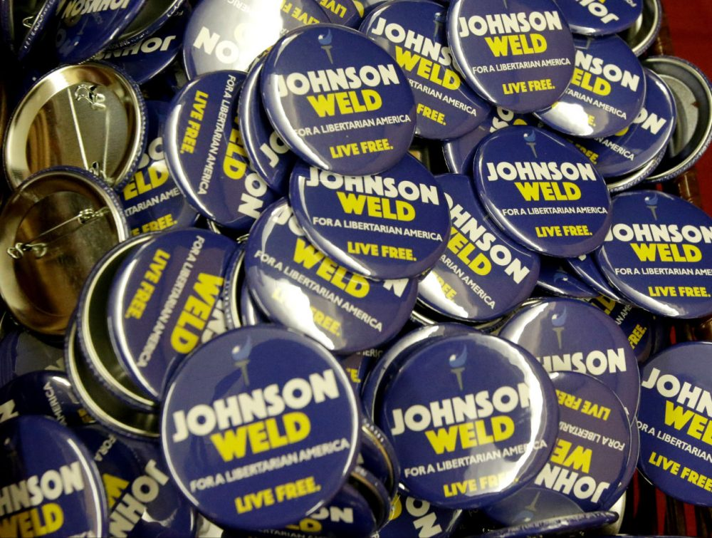 Campaign buttons for Libertarian presidential candidate Gary Johnson and vice presidential candidate Bill Weld at the National Libertarian Party Convention on Friday in Orlando. (John Raoux/AP)