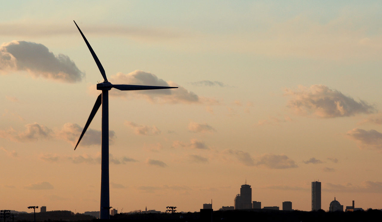 A wind turbine stands next to Hull High School in the shadow of Boston. (Stephen Savoia/AP File)