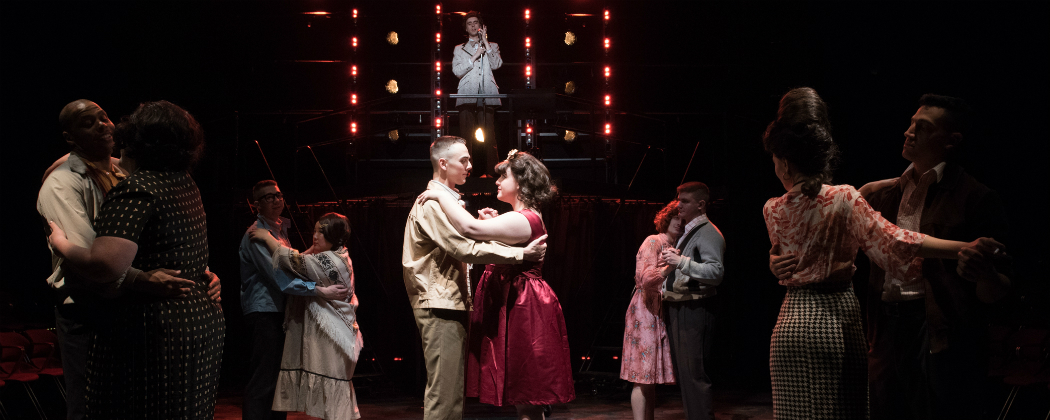 """Jordan J. Ford and Alejandra M. Parrilla (center) and members of the cast SpeakEasy Stage's """"Dogfight."""" (Courtesy of Glenn Perry Photography)"""
