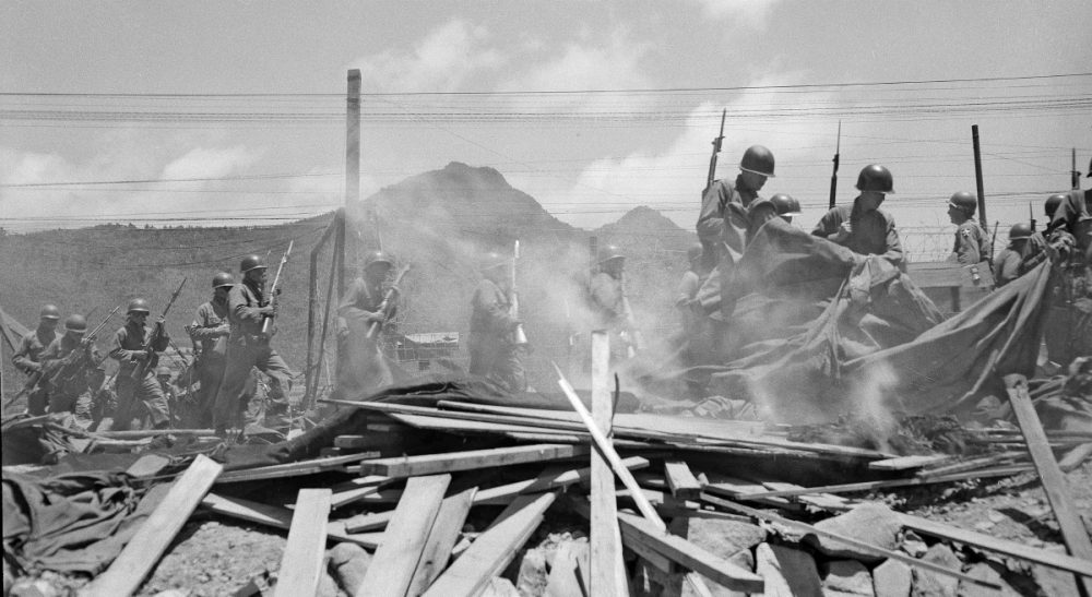 The daughter of a Korean War veteran recalls her loving father's gifts -- and ghosts.  Pictured: A tent and some banners and signs from compound 85 are burned outside the compound during the Korean War, June 7, 1952. (George Sweers/AP)