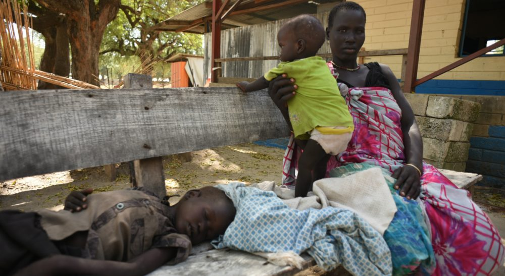 Nyawel Top sits with her two sick children in a Doctors Without Borders clinic in Leer town, South Sudan on Tuesday Dec. 15, 2015. The country is in the throes of a civil war that in two and a half years has killed tens of thousands of people and forced more than 2 million from their homes. (Jason Patinkin/AP)