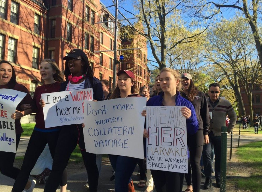 Harvard students protest the school's recent policies targeting students in single-sex final clubs, sororities and fraternities. (Fred Thys/WBUR)