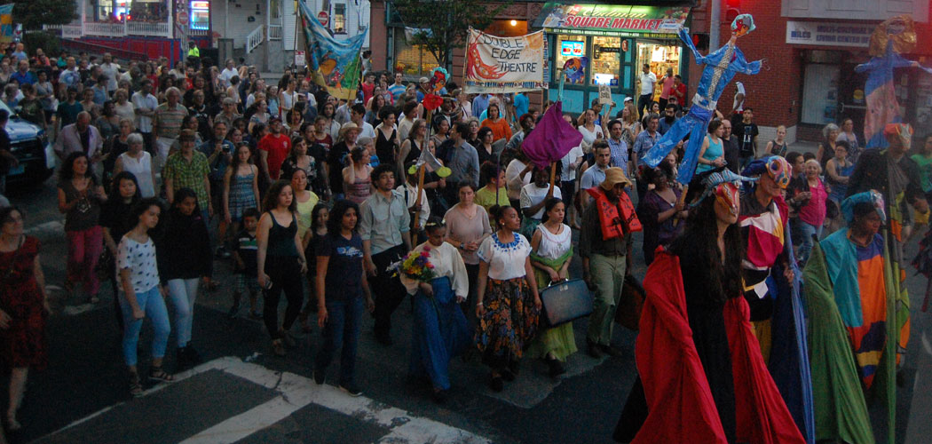 "Actors and audience parade down Centre Street during Double Edge Theatre's ""Latin American Spectacle"" in Boston on May 28, 2016. (Greg Cook)"