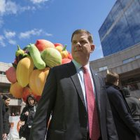 """Boston Mayor Marty Walsh in Faneuil Hall in front of Choi Jeong Hwa's """"Fruit Tree."""" The tree was inflated in April as part of the MFA's Megacities exhibition. (Jesse Costa/WBUR)"""