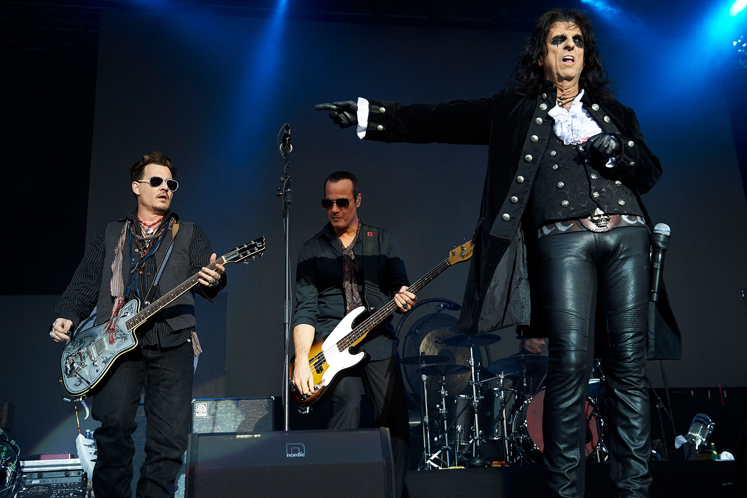 Johnny Depp, left, and Alice Cooper, right, lead the Hollywood Vampires during a performance in Denmark on June 1. (Claus Bonnerup/Polfoto via AP)