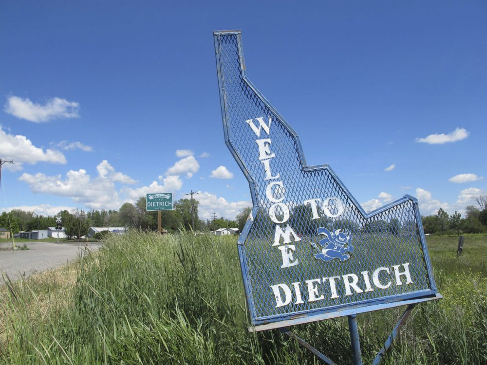 A sign welcomes residents and visitors to the tiny town in Dietrich, Idaho on Thursday, May 26, 2016. The small community is struggling with the national attention brought by reports that a disabled black football player was raped by his white high school teammates. (Kimberlee Kruesi/AP)