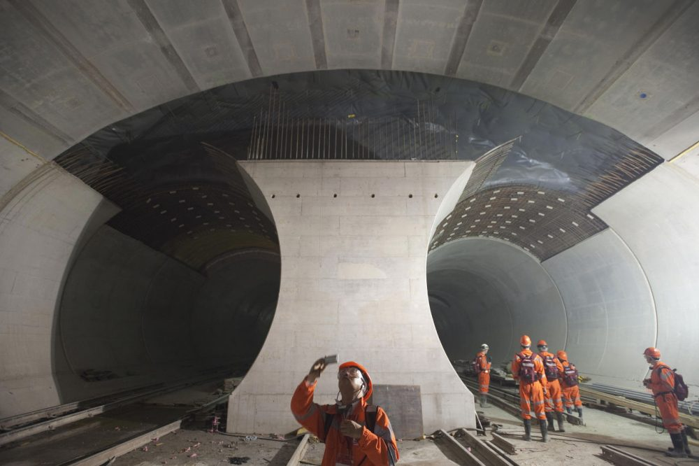A Chinese journalist takes a picture of the 57-kilometre (35-mile) railway tunnel under construction in the Alps at Sedrun on May 6, 2009. The tunnel, which opened this week, is meant to increase rail capacity for freight and passengers through the Alps and between northern Europe and Italy. (Sebastien Bozon/AFP/Getty Images)