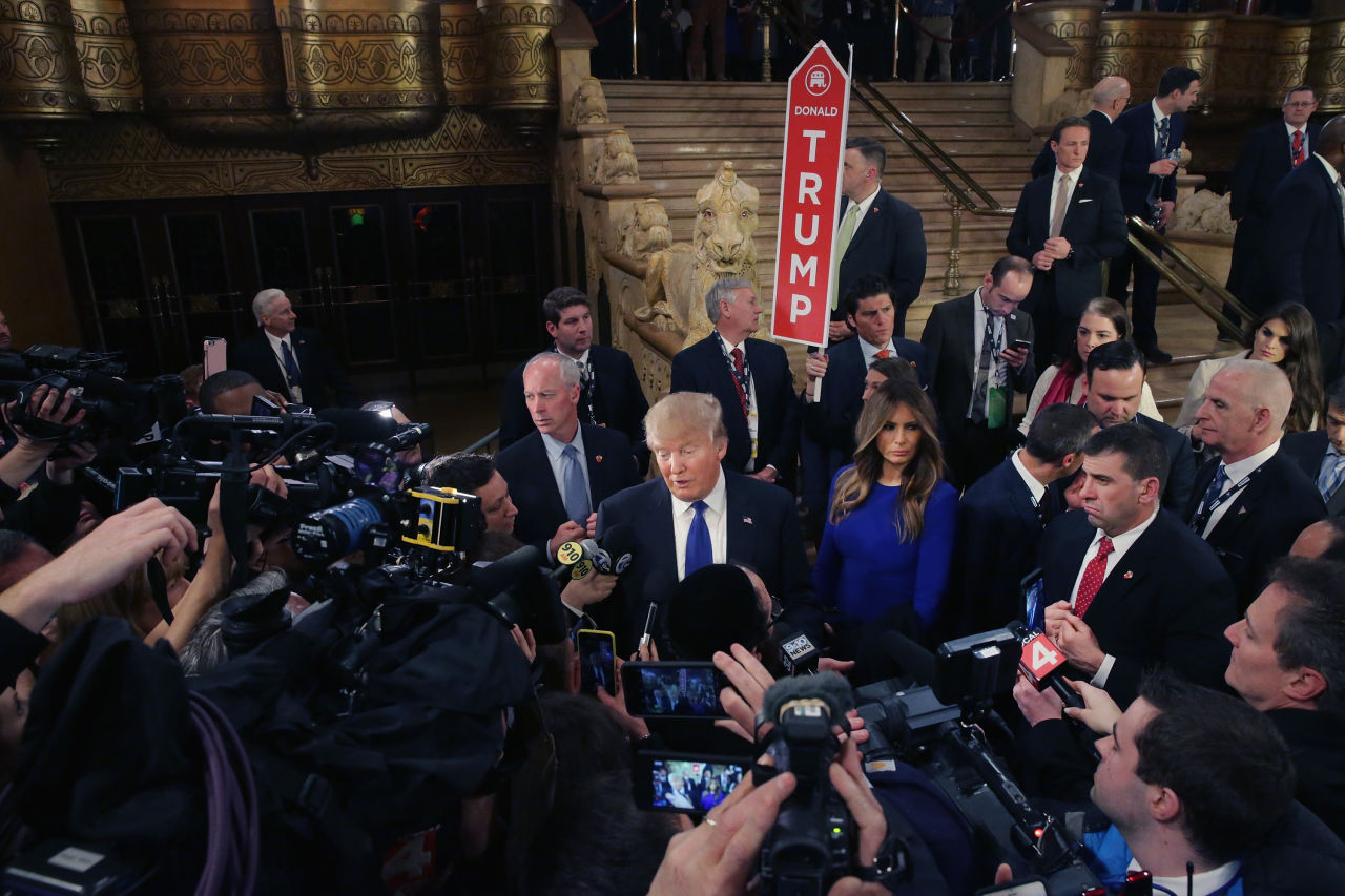 Republican presidential candidate Donald Trump greets reporters in the spin room following a debate sponsored by Fox News at the Fox Theatre on March 3, 2016 in Detroit, Michigan. (Chip Somodevilla/Getty Images)