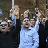 In this Sept. 27, 2015 photo, Iranian protesters chant slogans in front of the Saudi Arabian Embassy in Tehran, Iran, during a gathering to blame the Arab country for a deadly stampede during the annual hajj pilgrimage. (Vahid Salemi/AP)