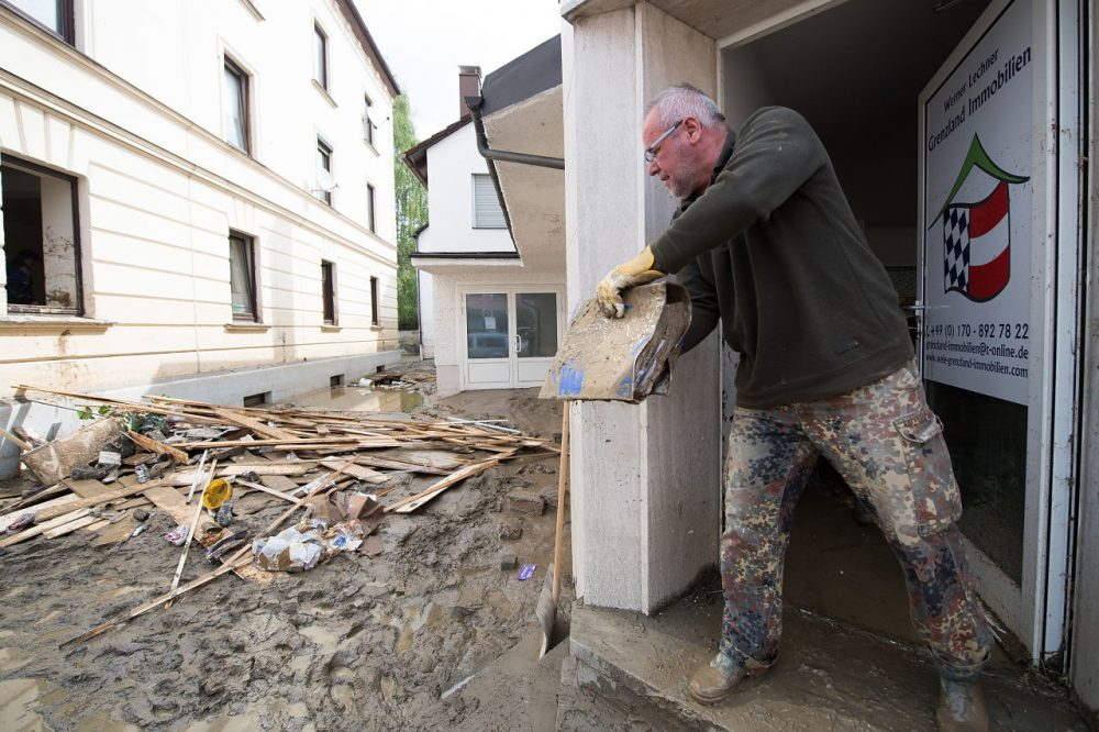 Werner Lechner throws a binder covered in mud out of his office following floods on June 3, 2016 in Simbach am Inn, Germany. Severe and sudden flooding in the region around Simbach hit communities on June 1, overturning cars, inundating homes and businesses and leaving at least six people dead. (Sebastian Widmann/Getty Images)