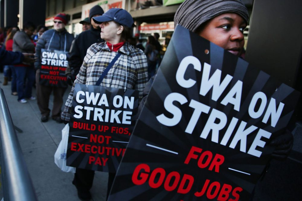 Hundreds of Verizon workers strike outside of the telecommunications company's Brooklyn offices on April 13, 2016 in New York City. Some officials are blaming the strike in part for weaker than anticipated job gains in May. (Spencer Platt/Getty Images)