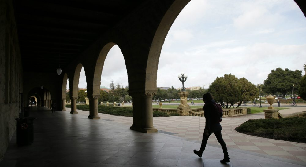 A six-month jail term for a former Stanford University student convicted of sexually assaulting an unconscious woman is being decried as a slap on the wrist. In this photo, a student walks on Stanford's campus on Wednesday, Jan. 13, 2016. (Marcio Jose Sanchez/AP)