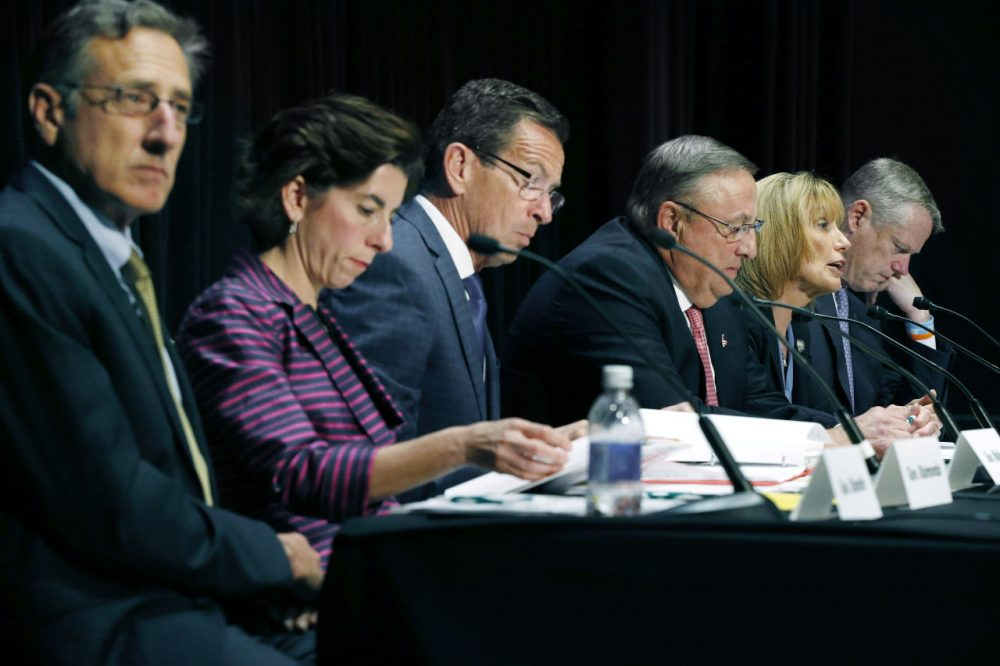 Seated from left are Vermont Gov. Peter Shumlin, Rhode Island Gov. Gina Raimondo, Connecticut Gov. Dannel P. Malloy, Maine Gov. Paul LePage, Hassan, and Massachusetts Gov. Charlie Baker. The governors met Tuesday in Boston to discuss strategies to deal with the opioid addiction problem in all their states. (Michael Dwyer/AP)