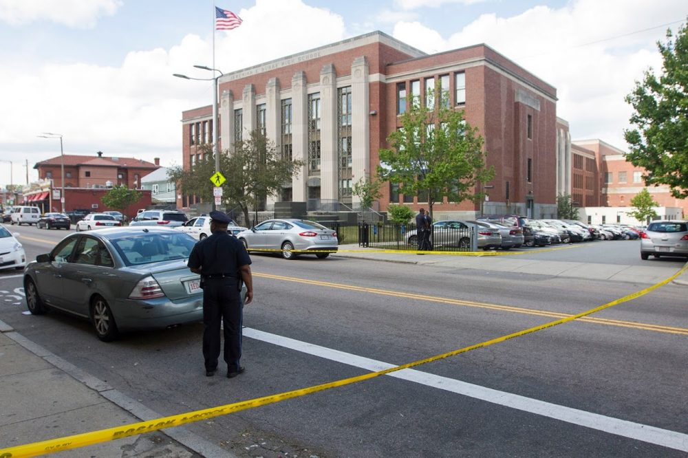 A Boston high school student was killed and three others wounded in a shooting near Jeremiah E. Burke High School on Washington Street in Dorchester on Wednesday afternoon. (Joe Difazio for WBUR)