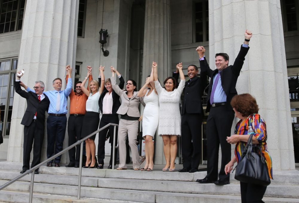Same-sex couples and their attorneys who had previously challenged the wedding ban celebrate on court steps after Circuit Court Judge Sarah Zabel lifted the stay, allowing same-sex couples to marry January 5, 2015 in Miami, Florida.  (Emily Michot-Pool/The Miami Herald/Getty Images)