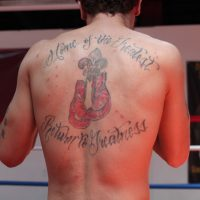 Braxton Carter, a 30-year-old fighter at TKO Boxing, got this tattoo honoring Muhammad Ali about a year before Ali's death. (Jacob Ryan/wfpl.org)