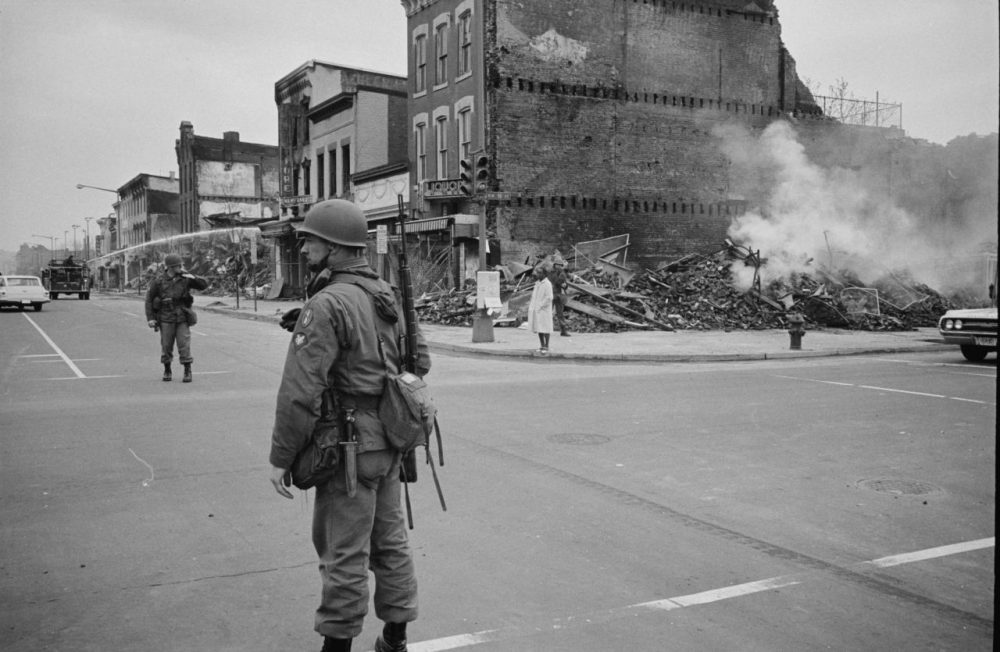 A soldier stands guard on the corner of 7th & N Street NW in Washington D.C. on April 8, 1968 with the ruins of buildings that were destroyed during the riots that followed the assassination of Martin Luther King, Jr. (Warren K. Leffler/Library of Congress)