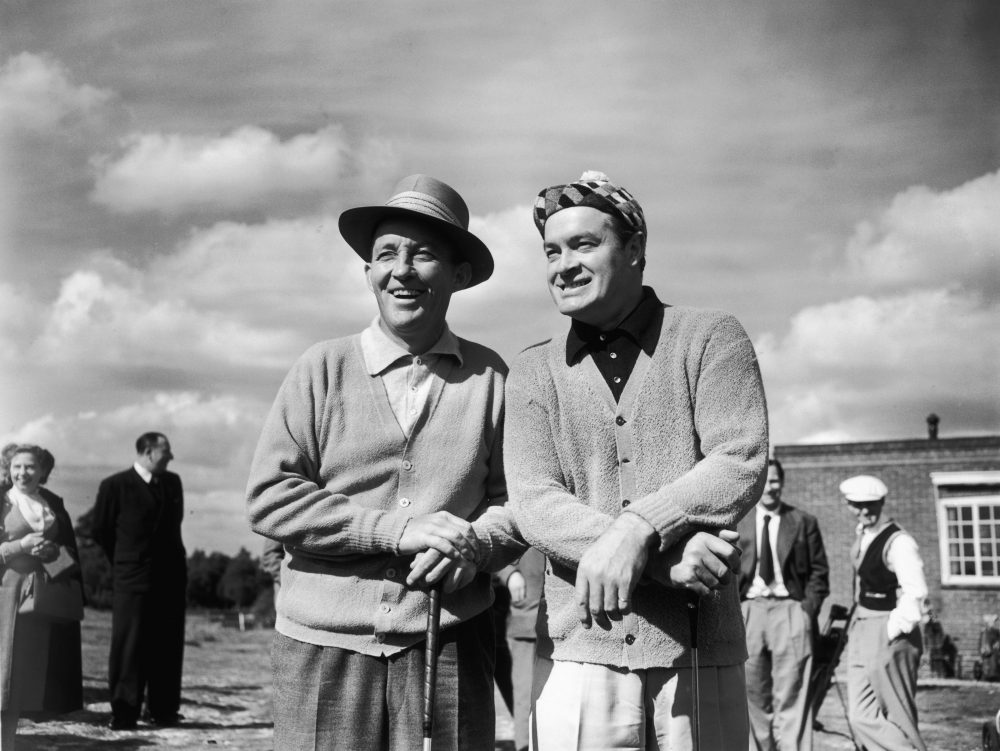Former pro golfer Nathaniel Crosby's earliest memories and life stories often involved a golf course and his father, the famous entertainer Bing Crosby (left), pictured here with Bob Hope. (Jimmy Sime/Central Press/Getty Images)