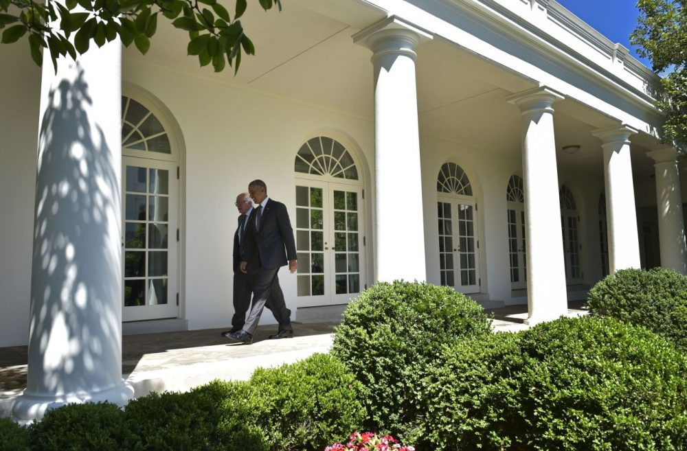 US President Barack Obama (R) walks with Democratic presidential candidate Bernie Sanders through the Colonnade for a meeting in the Oval Office on June 9, 2016 at the White House in Washington, DC. (MANDEL NGAN/AFP/Getty Images)