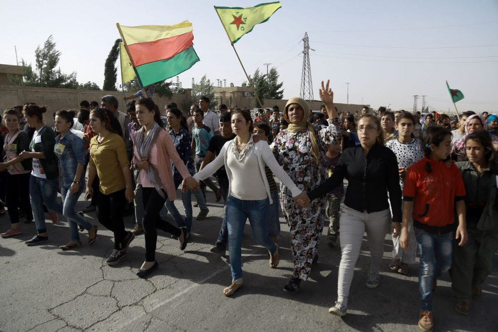 Syrian Kurds march during the funeral of fighters, who died during an assault launched by Arab and Kurdish forces against Islamic State (IS) group fighters in the town of Manbij, in the Syrian Kurdish town of Kobane on June 4, 2016. (Delil Souleiman/AFP/Getty Images)