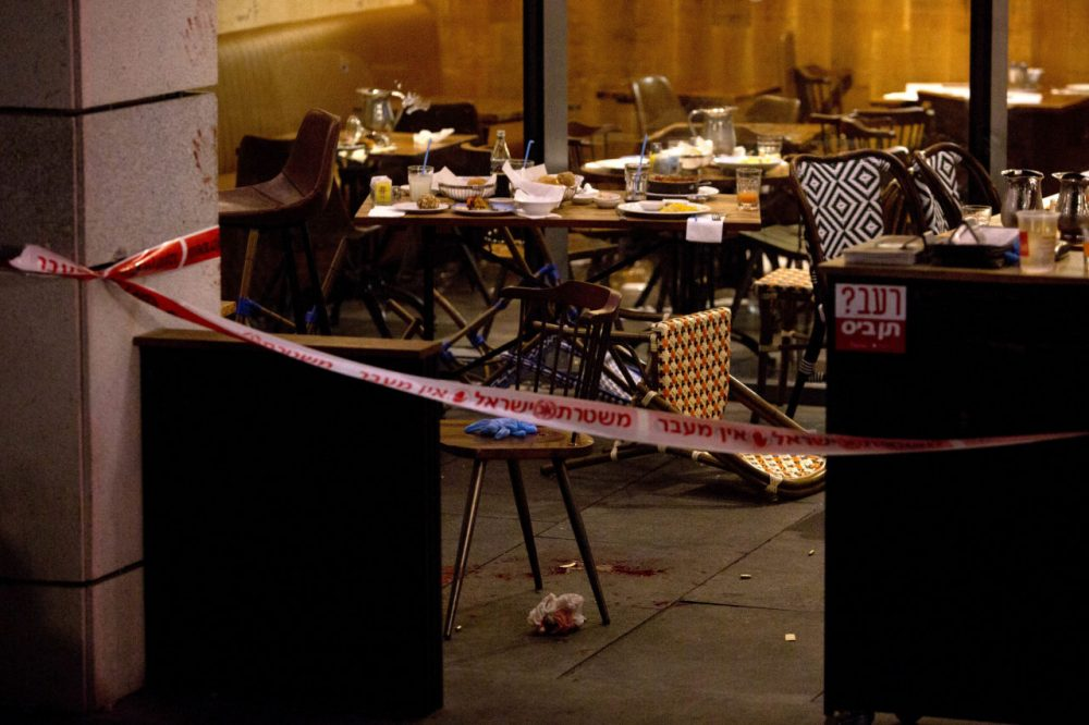 The scene of a shooting attack is seen in Tel Aviv, Israel, Wednesday, June 8, 2016. Two Palestinian gunmen opened fire in central Tel Aviv Wednesday night, killing three people and wounding at least five others, Israel police said. (AP Photo/Sebastian Scheiner)