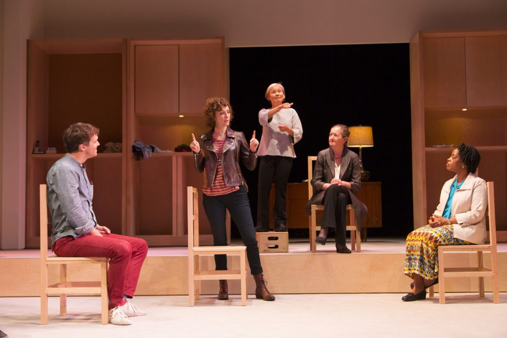 """A scene from """"I Was Most Alive With You,"""" which features shadow interpreters to create a richer experience for deaf audiences. (Courtesy The Huntington Theatre Company)"""