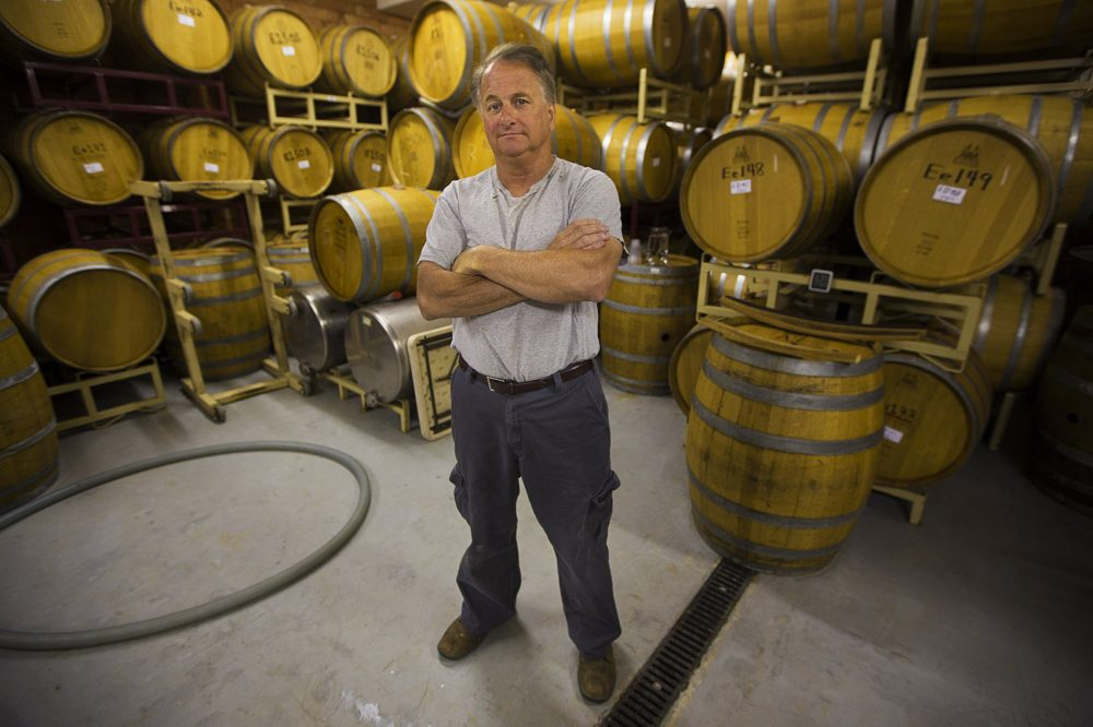 Nashoba Valley Winery owner Rich Pelletier in the cask room (Jesse Costa/WBUR)