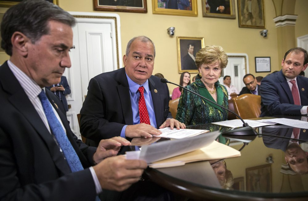 From left, Rep. Gary Palmer, R-Ala., Del. Gregorio Kilili Camacho Sablan, D-Northern Mariana Islands, Del. Madeleine Bordallo, D-Guam, and Rep. Andy Barr, R-Ky., go before the House Rules Committee to prepare a bill for floor debate that would create a financial control board for Puerto Rico and restructure some of the U.S. territory's $70 billion debt, at the Capitol in Washington, Wednesday, June 8, 2016. (AP Photo/J. Scott Applewhite).