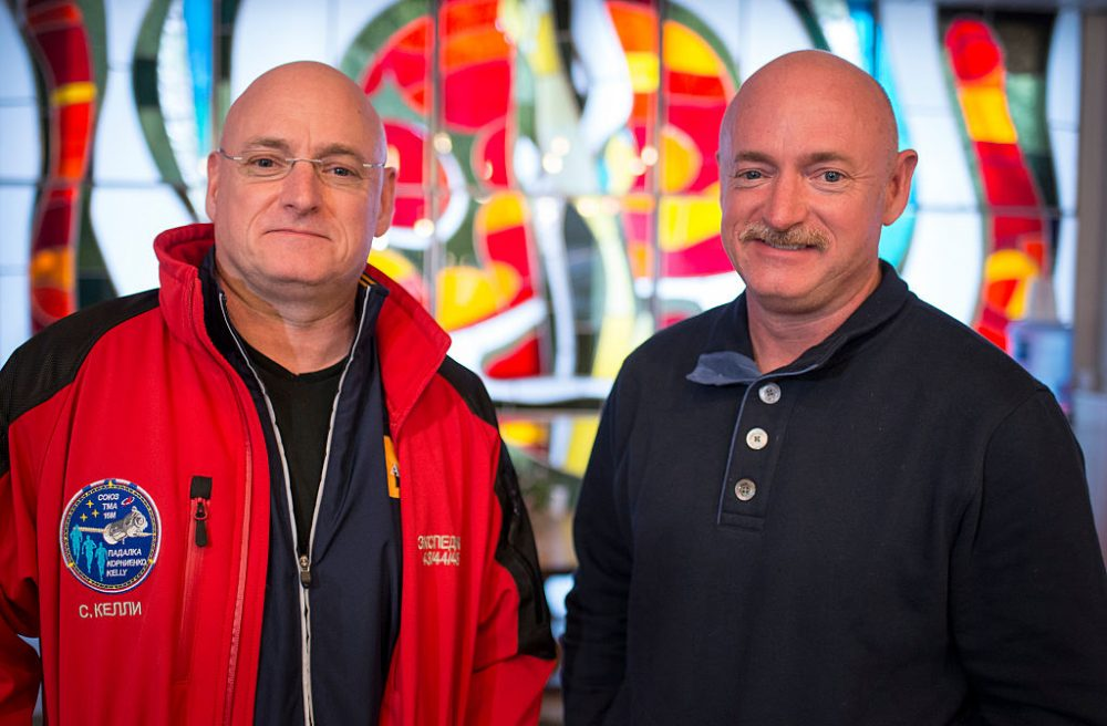 Expedition 43 NASA Astronaut Scott Kelly, left, and his identical twin brother Mark Kelly, pose for a photograph Thursday, March 26, 2015 at the Cosmonaut Hotel in Baikonur, Kazakhstan.  (Bill Ingalls/NASA via Getty Images)