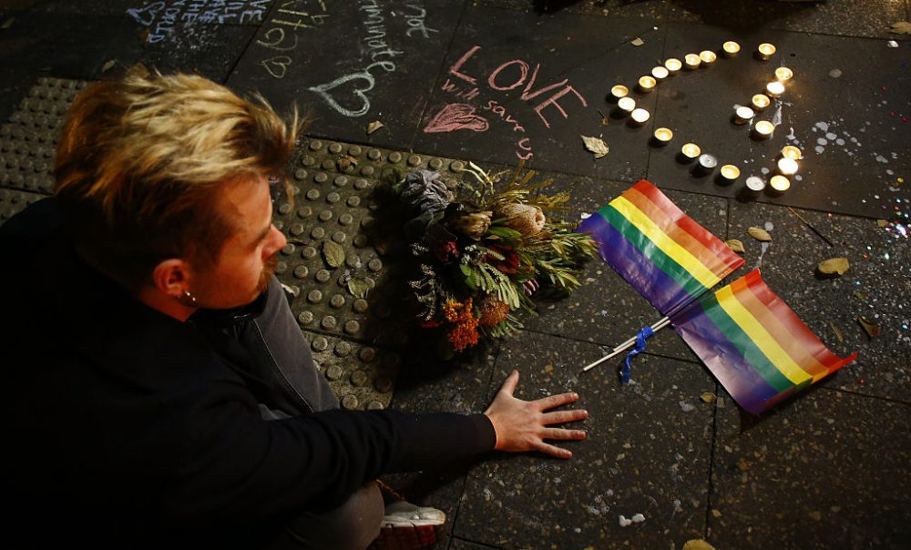 A man attends a candlelight vigil for the victims of the Pulse Nightclub shooting in Orlando, Florida, at Newtown Neighbourhood Centre on June 13, 2016 in Sydney, Australia. (Daniel Munoz/Getty Images)