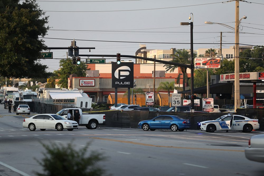 Law enforcement officials investigate near the Pulse Nightclub where Omar Mateen allegedly killed at least 50 people on June 13, 2016 in Orlando, Florida. (Joe Raedle/Getty Images)