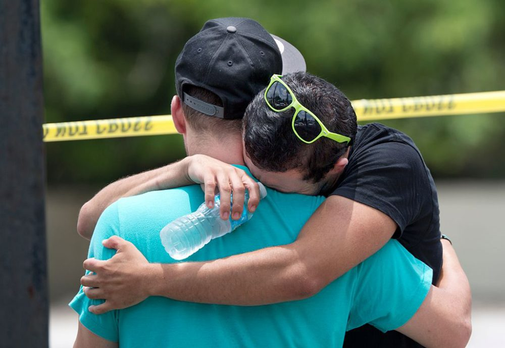 Supported by a friend, a man weeps for victims of the mass shooting just a block from the scene in Orlando, Florida, on June 12, 2016.  (Gregg Newton/AFP/Getty Images)