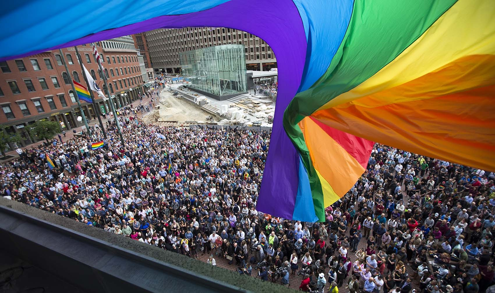 Hundreds gathered on City Hall Plaza in honor of those killed at the Pulse Dance Club in Orlando. (Jesse Costa/WBUR)