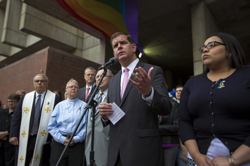 "Mayor Marty Walsh addresses the crowd of hundreds outside City Hall to honor the victims of Orlando. ""This is a very sad occasion for us to gather at City Hall,"" Walsh said. (Jesse Costa/WBUR)"