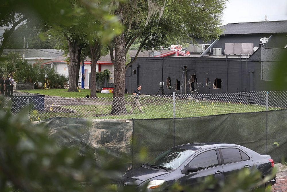 FBI agents investigate near the damaged rear wall of the Pulse Nightclub where Omar Mateen allegedly killed at least 50 people on June 12, 2016 in Orlando, Florida. The mass shooting killed at least 50 people and injuring 53 others in what is the deadliest mass shooting in the country's history.  ( Joe Raedle/Getty Images)