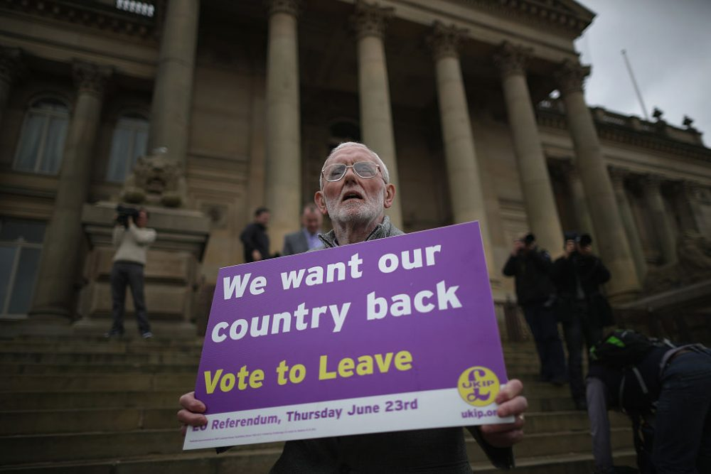 A Vote to Leave campaigner holds a placard as Leader of the United Kingdom Independence Party (UKIP), Nigel Farage campaigns for votes to leave the European Union in the referendum on May 25, 2016 in Bolton, England, encouraging British people to vote to leave the EU on 23rd June 2016.  (Christopher Furlong/Getty Images)