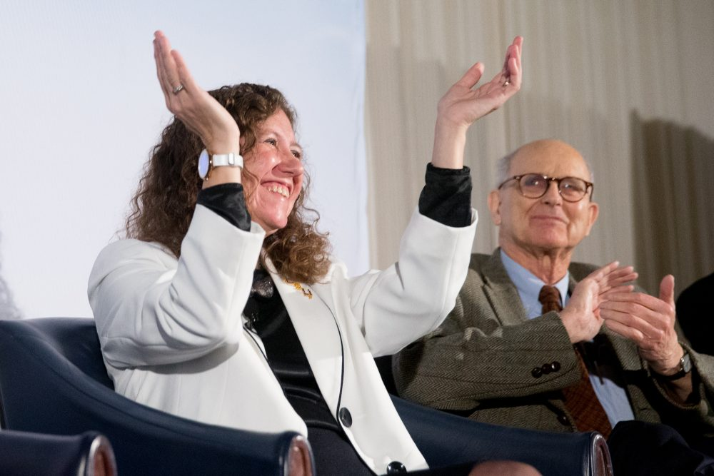 Laser Interferometer Gravitational-Wave Observatory (LIGO) Scientific Collaboration Spokesperson Gabriela Gonzalez, and Laser Interferometer Gravitational-Wave Observatory (LIGO) Co-Founder Rainer Weiss applaud during a news conference at the National Press Club in Washington, Thursday, Feb. 11, 2016, as it is announced that scientists they have finally detected gravitational waves, the ripples in the fabric of space-time that Einstein predicted a century ago. (Andrew Harnik/AP)