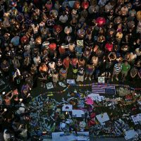Mourners hold candles while observing a moment of silence during a vigil outside the Dr. Phillips Center for the Performing Arts for the mass shooting victims at the Pulse nightclub June 13, 2016 in Orlando, Florida. (Brendan Smialowski/AFP/Getty)