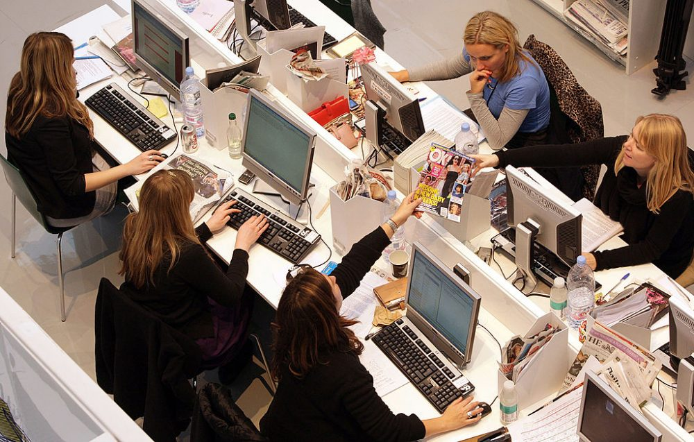 Production staff on the weekly fashion magazine, Grazia edit the magazine in a temporary office inside the Westfield shopping centre on November 3, 2008 in London. (Oli Scarff/Getty Images)
