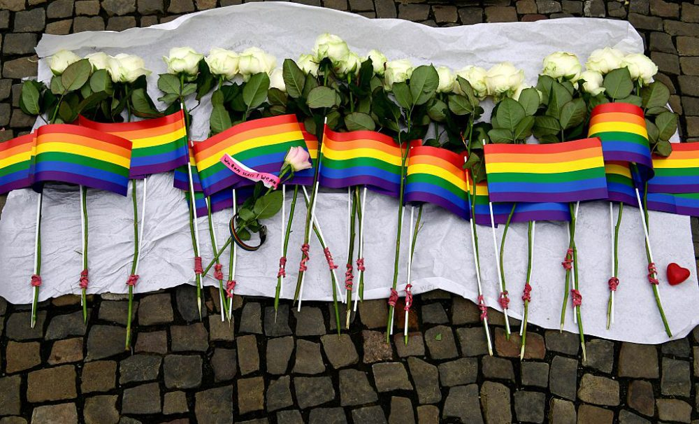 White roses and rainbow flags are displayed in front of the US Embassy in Berlin on June 13, 2016 as people pay tribute to the victims of the Orlando killing. (John  MacDougall/AFP/Getty Images)