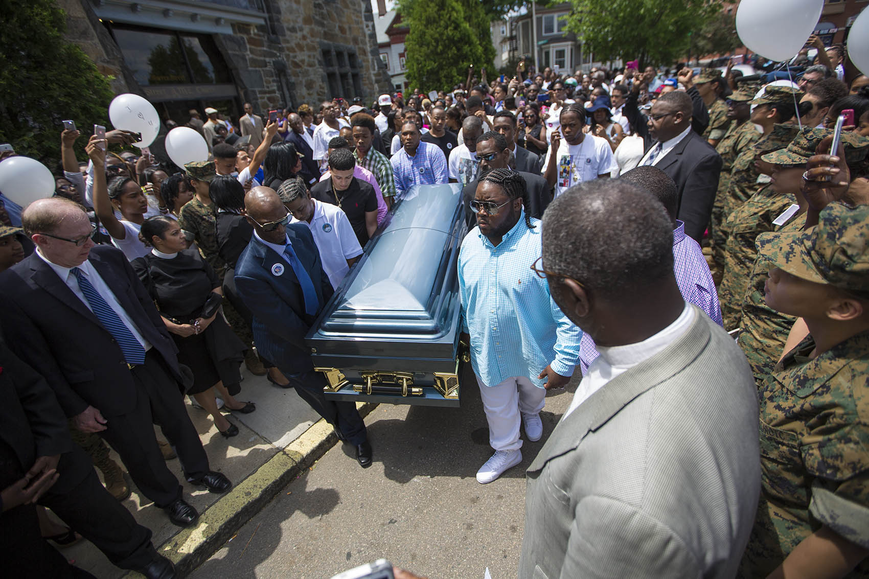 Pallbearers carry the casket of Raekwon Brown out of the Charles Street AME Church. (Jesse Costa/WBUR)