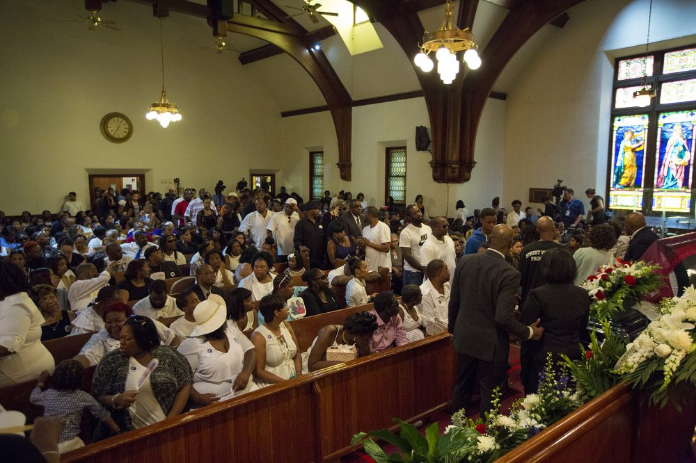 Mourners filled the Charles Street AME Church and waited in a line flowing outside as they paid their respects to Raekwon during the wake. (Jesse Costa/WBUR)